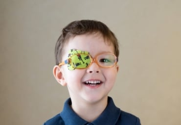 young boy with adhesive eye patch over his eye