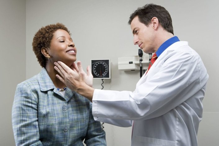 doctor checking lymph nodes of a patient