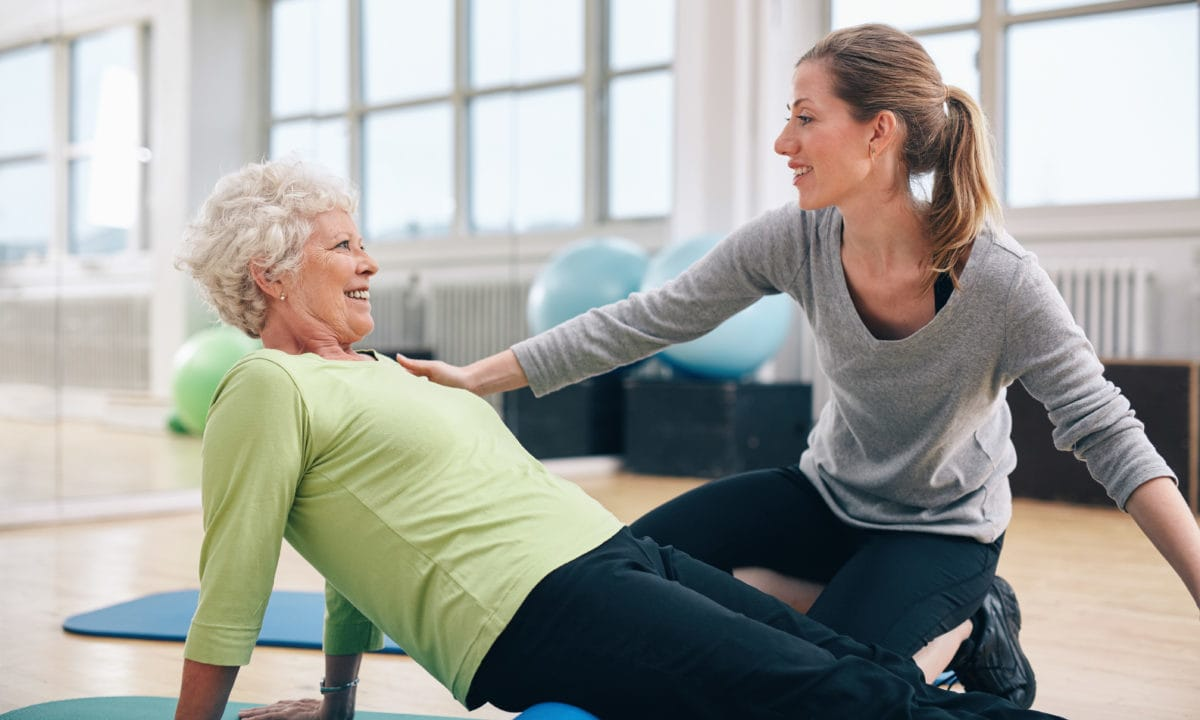 Physical therapist working with a senior woman