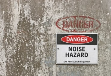 "A picture of a sign that reads, ""Danger: Noise Hazard."""