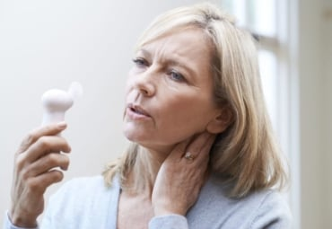 Mature woman experiencing a hot flash from menopause