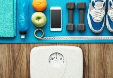 Collection of the tools you need to lose weight, including water, healthy snacks, fitness equipment, and a scale