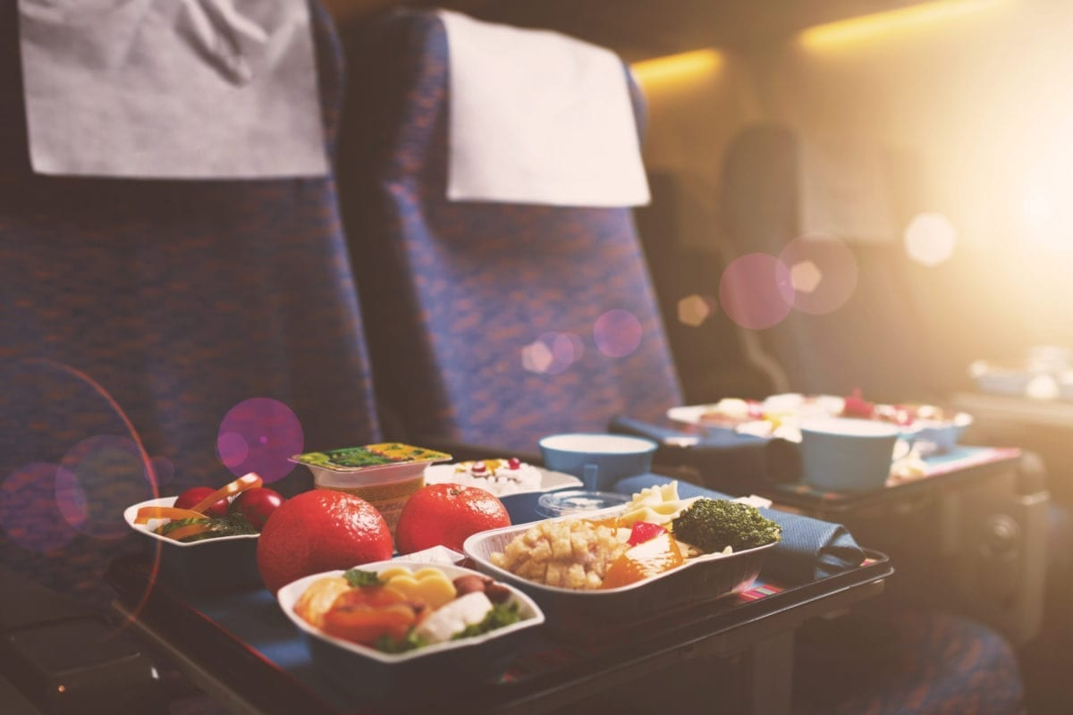 Trays with healthy food on an airplane