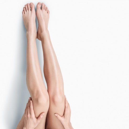 A photo of female legs isolated on a white background