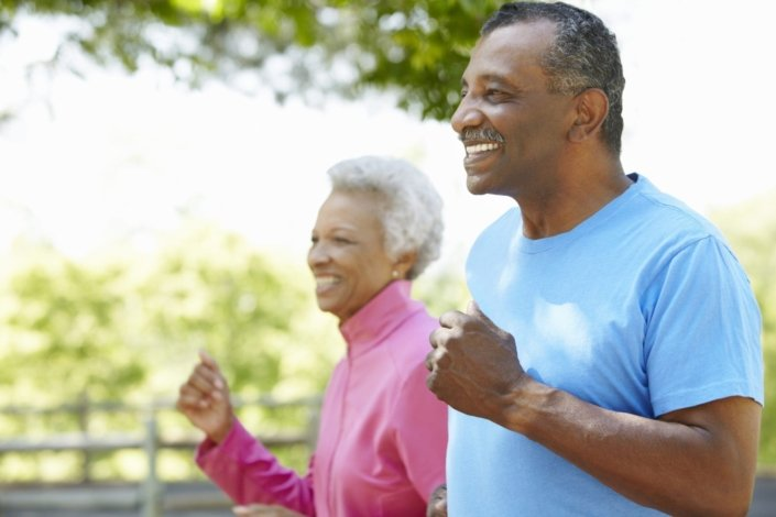 close-up of older couple jogging in a park