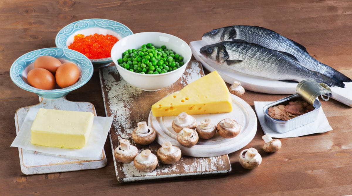 Fish, eggs, dairy products and vegetables sitting on table
