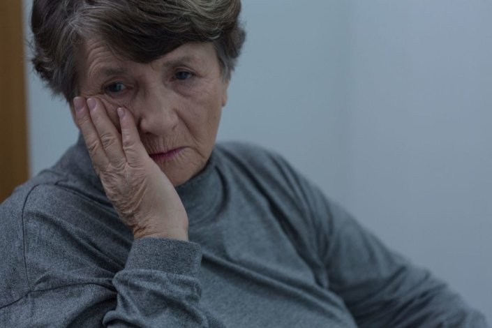 Portrait of older woman suffering for depression