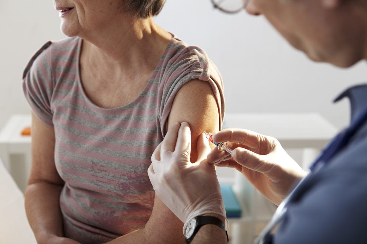 Older adult getting a flu shot