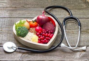 Healthy foods and a stethoscope.