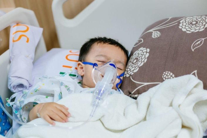 Toddler with oxygen mask