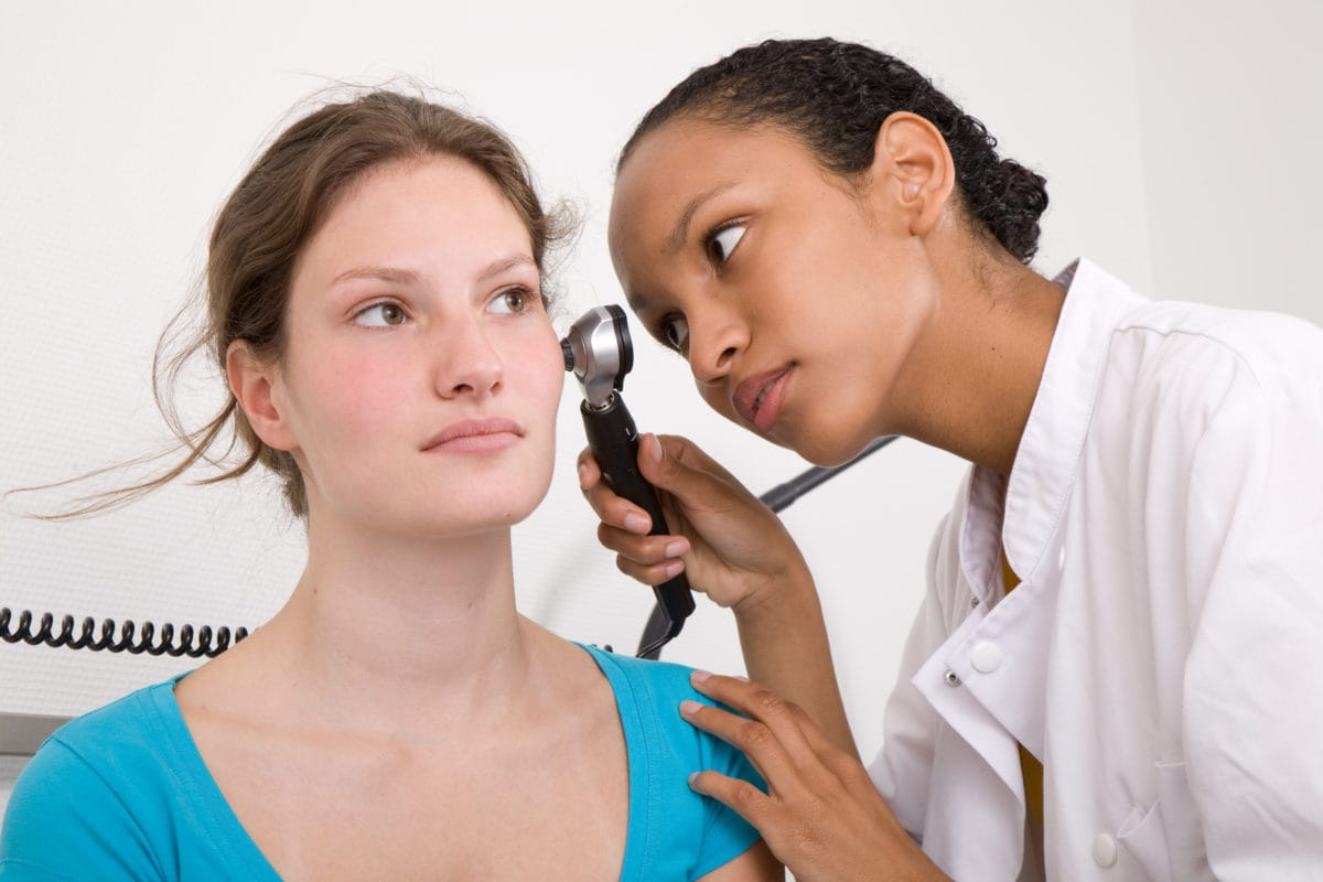 Teenagers How To Stay Healthy  Familydoctororg Doctor Examining Patients Ear With Otoscope