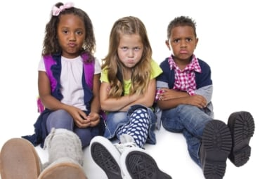 Group of three angry or upset children
