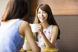 Two young women chatting in a coffee shop