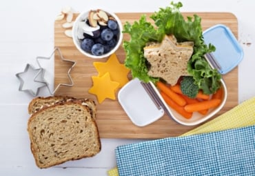 healthy school lunch with star-shaped sandwich, fruit and vegetables