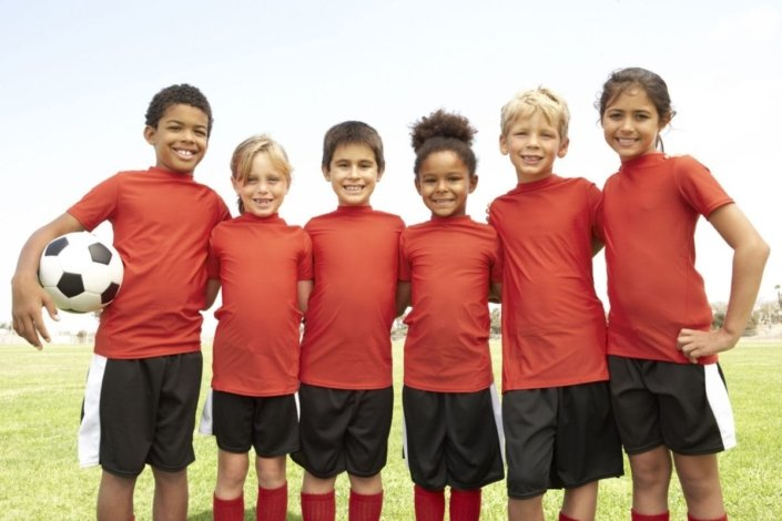 young children pose after playing soccer