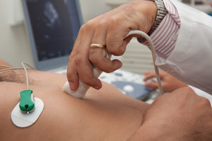 doctor performs an echocardiogram to check the heart
