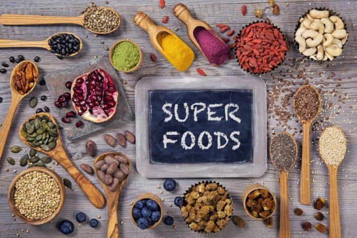 superfoods in bowls and spoons on a table