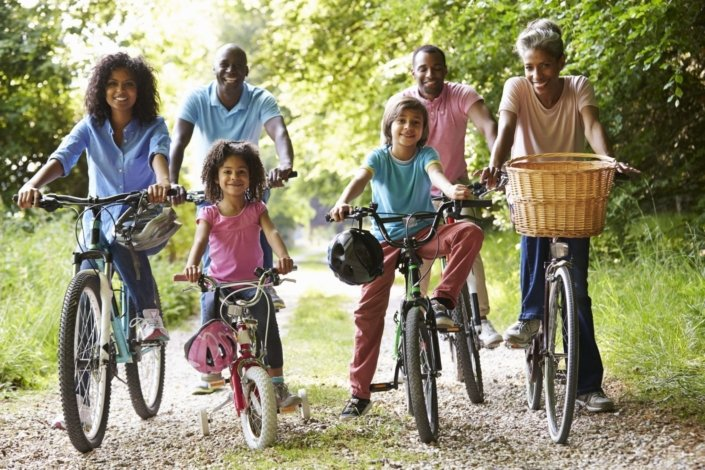 multigenerational family riding their bikes
