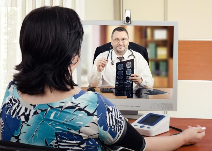 a woman using telemedicine to speak with a doctor